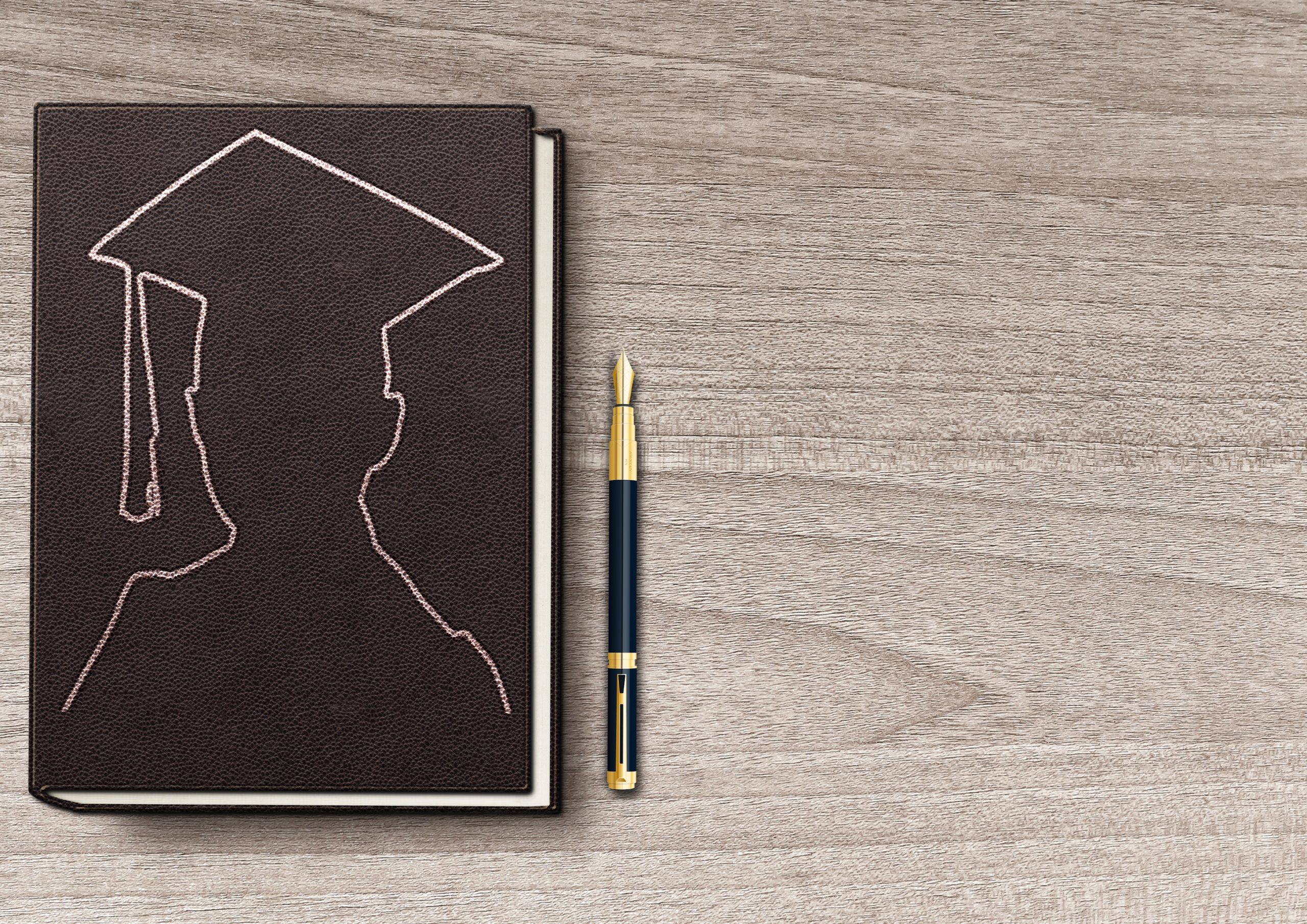 Student Book With Pen On Wooden Board Chalk outline of a graduate