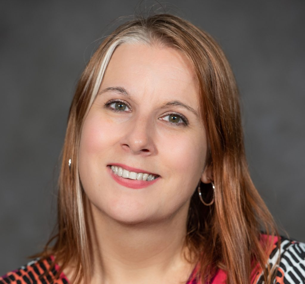 Head shot of Data Strategy in Colleges and Universities author Dr. Angela Henderson.