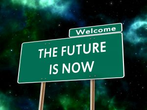 This is an image of a sign that says the future is now, suggesting forward thinking.
