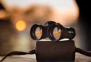 Canva-Black-Binocular-on-Round-Device-1