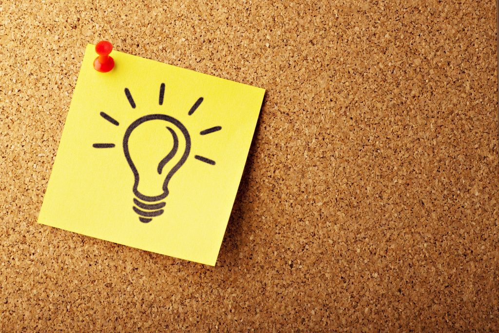 Image of a cork board with a yellow post-it note with a drawing of a light bulb pinned to it. Maybe someone has an idea related to IPEDS outcome measures.