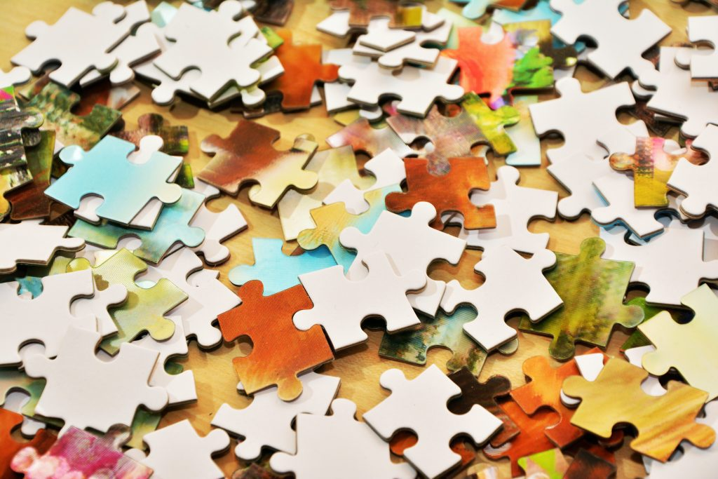 Pile of puzzle pieces representing tough problems.