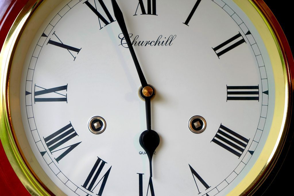 Large clock face about to turn 6:00 representing approaching accreditation visit