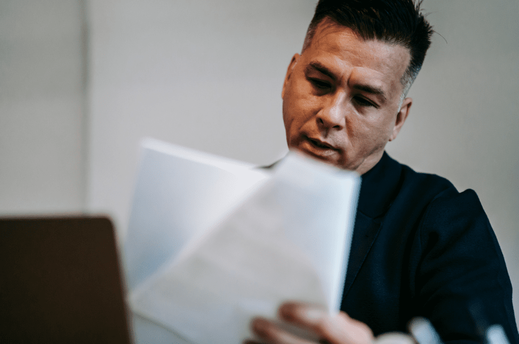 Man pre-reading an accreditation report